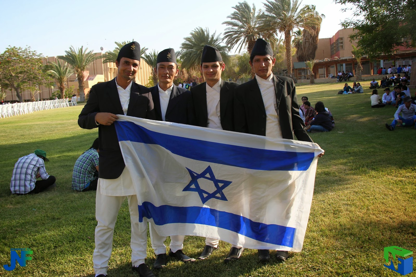 AICAT students holding Israeli flag