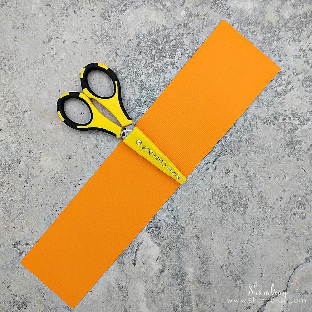 Orange paper and scissors