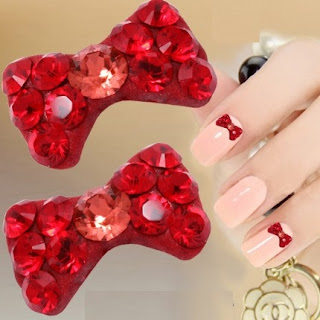 http://www.bijuteriifrumoase.ro/cumpara/bijuterii-rosii-pentru-unghii-bow-tie-u04-11mm-1393