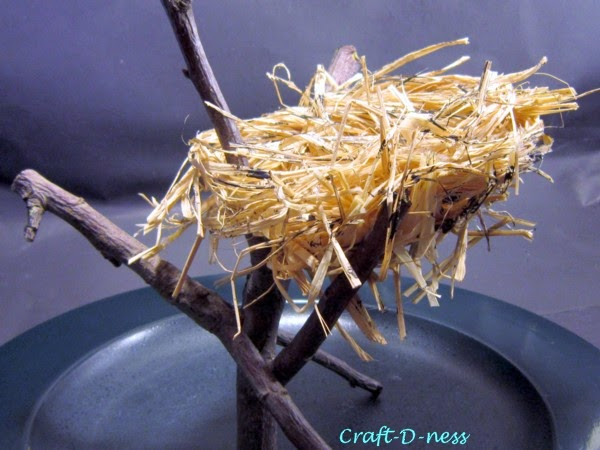 Raffia Nest in twig branches