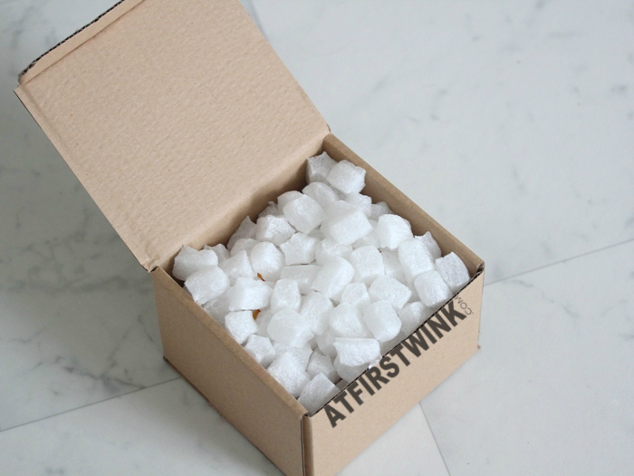opening a Lush wrapped gifts packing peanuts