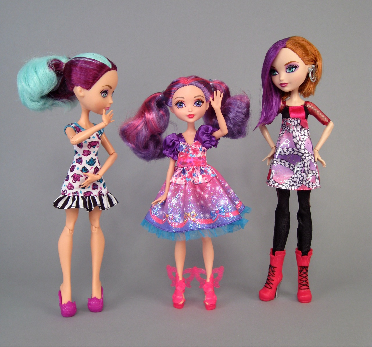Barbie s princess malucia flanked by madeline hatter left and poppy o hair right