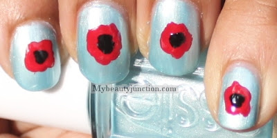 Remembrance Day poppy nail art with Essie Barbados Blue swatch