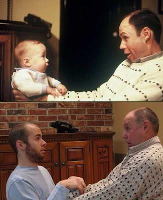 papá cargado a su hijo