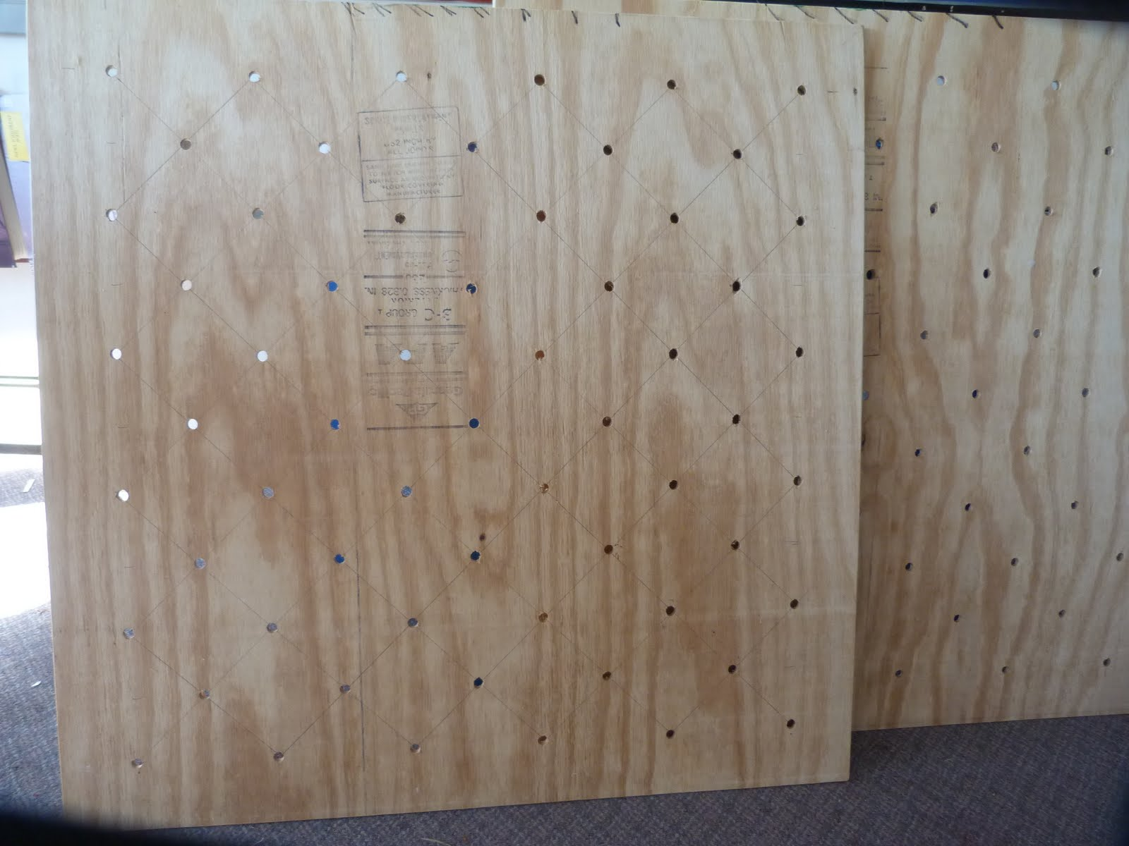 hole cut all 112 tufted holes from 1 and a half inch foam, and glued ...