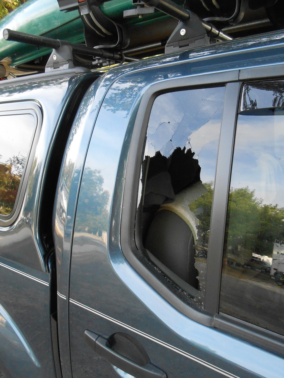 how to break a car window with a screwdriver