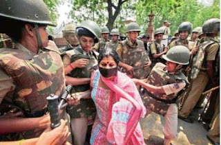 Police detain people outside the Parliament protesting against the rape of in New Delhi on Monday