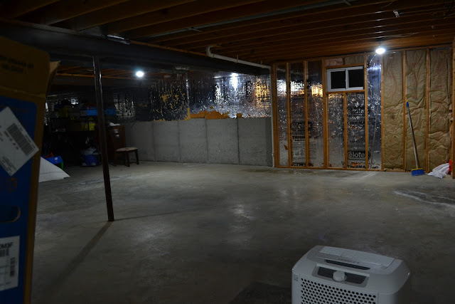 we have this unfinished basement that looks like this half basement