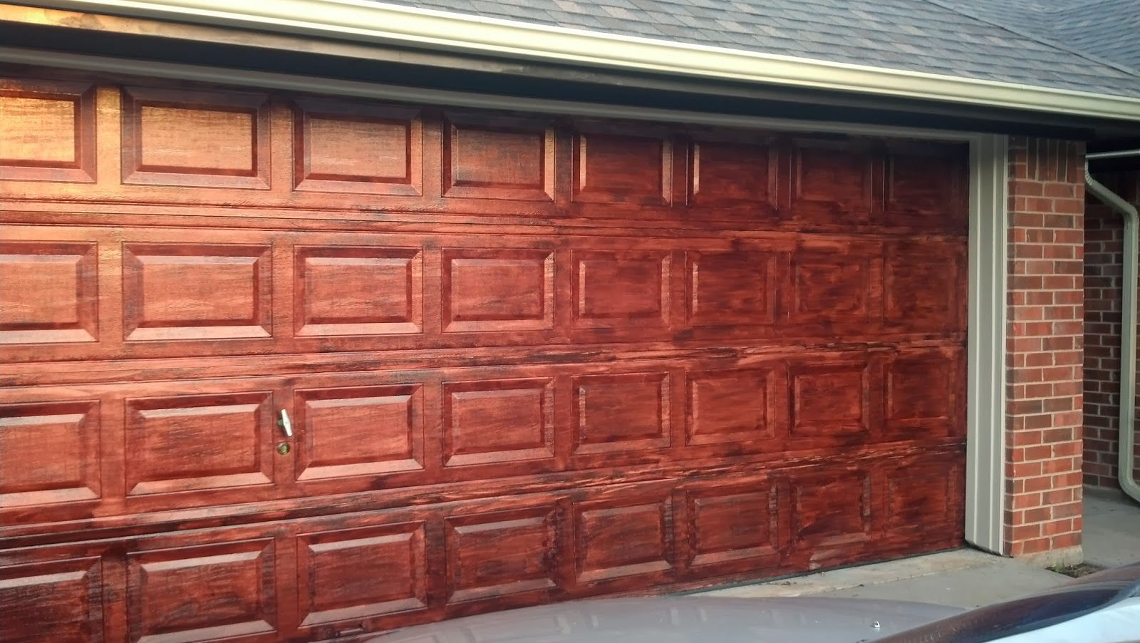 Itu0027s a little spotty as you can see. & Fix Lovely: How to stain your garage door to look like wood