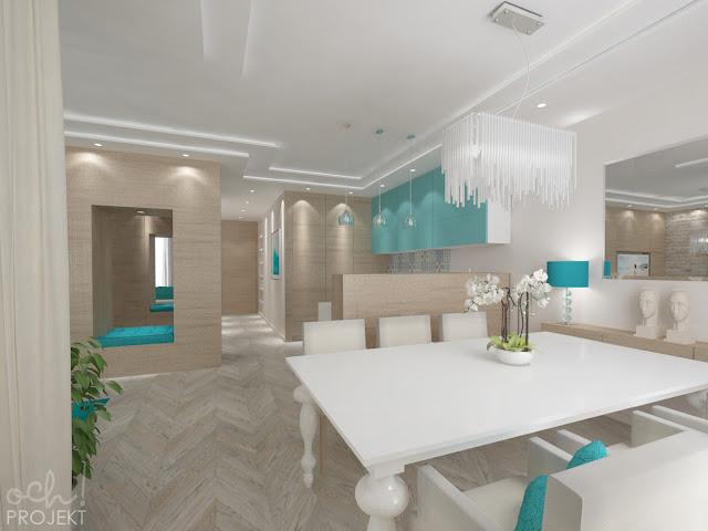 turkusowy salon z aneksem kuchennym