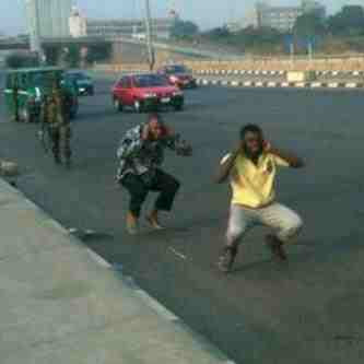 Grown Up Nigerian Men Doing Frog Jump On The Street Under The Soldier ...