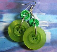 Drop dangle earrings have big bright chartreuse fashion buttons hanging from smaller kelly green buttons
