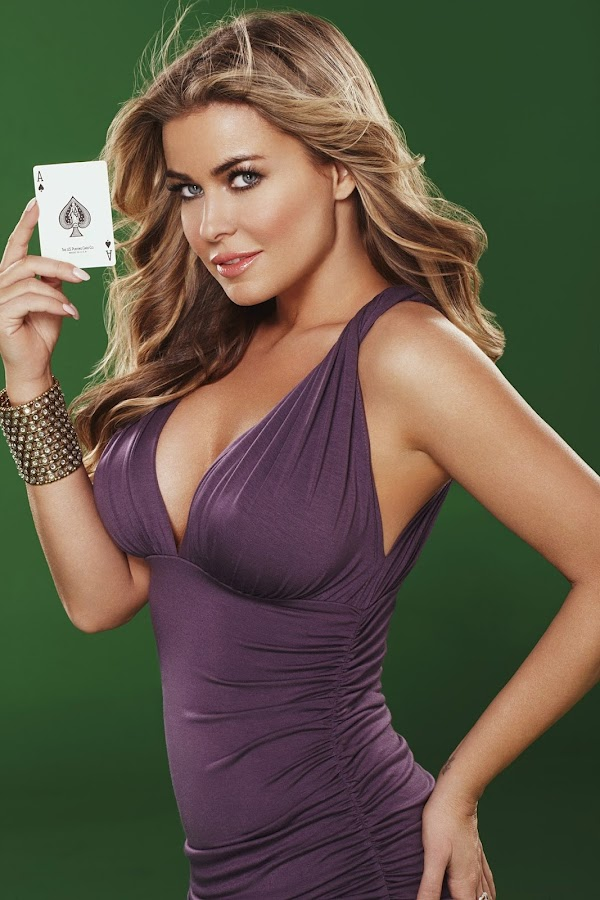 Carmen Electra in a purple dress holding a card in promo shot  for Pokerist Texas Hold Em Poker Game