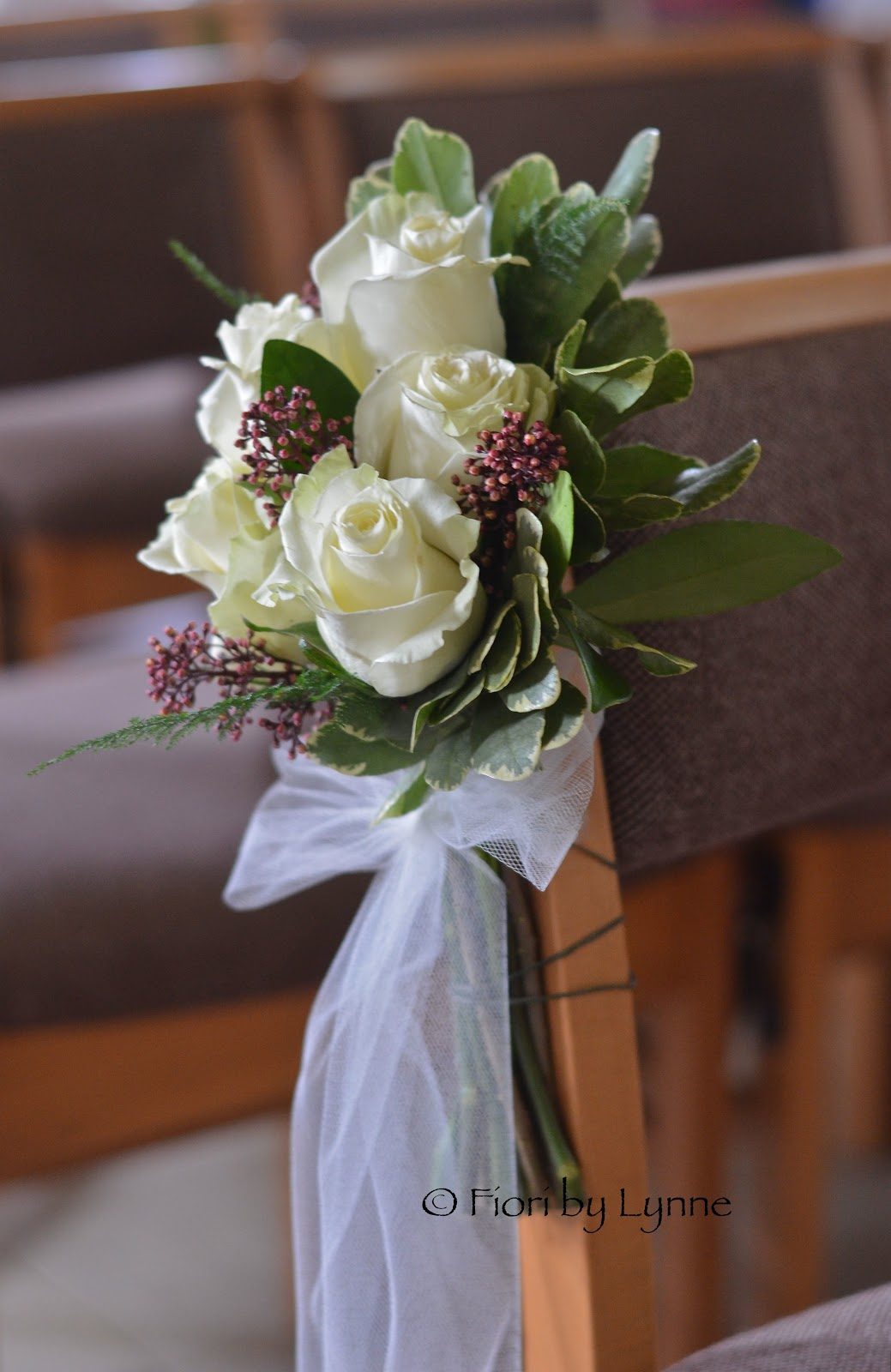 Co Ordinating Pew Ends Of Ivory Roses Burgundy Skimmia Finished With