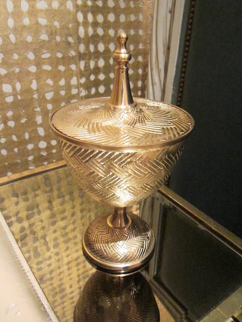 gold container on a glass nesting table in the Windsor house