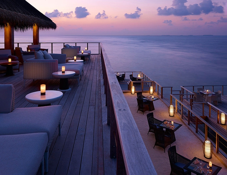 Deck with chairs at sunset in Luxury Dusit Thani Resort in Maldives