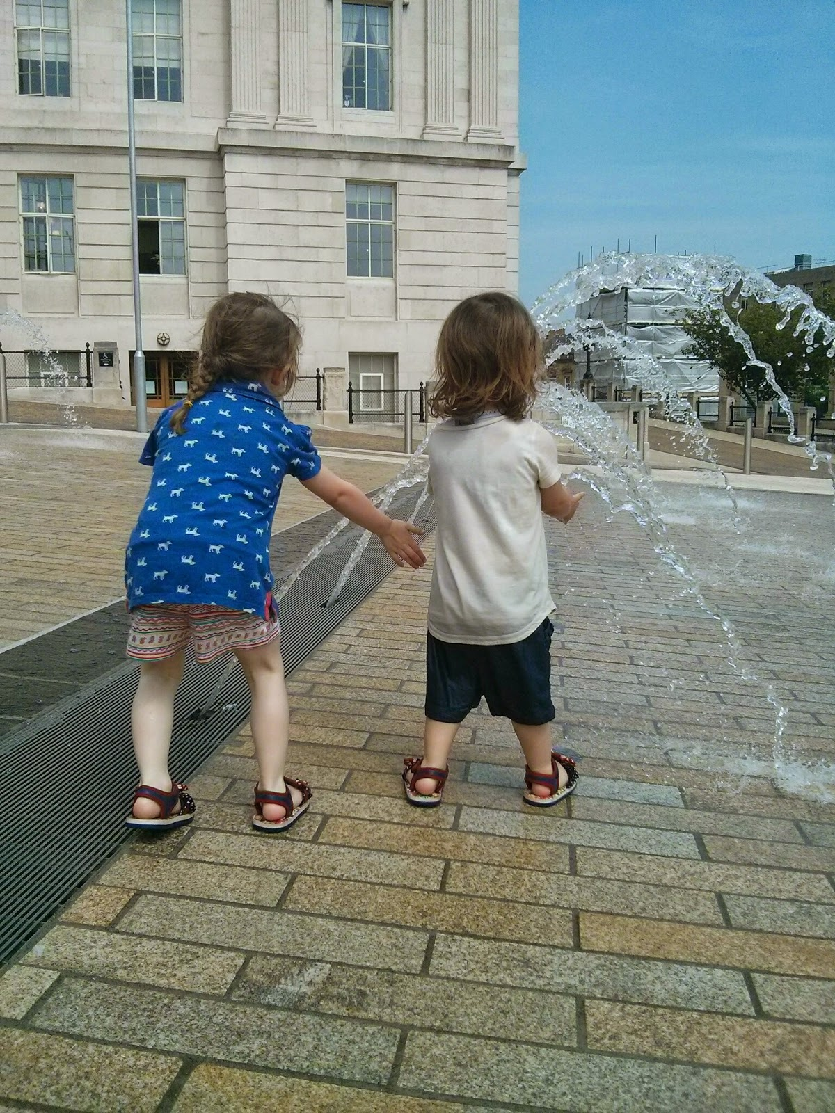 The girls playing with the fountains