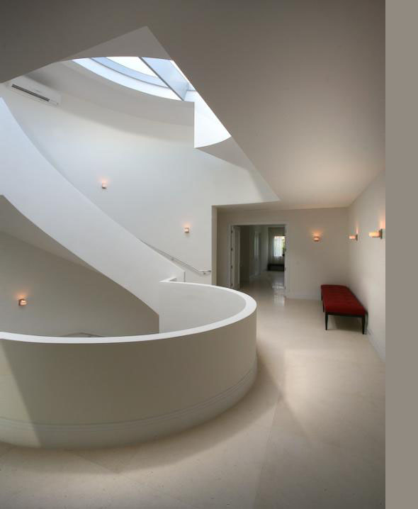 Spiral concrete staircase in the Modern Villa by Touzet Studio