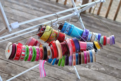 Easy Ribbon Storage Solution: keep spools of ribbon organized with wire hangers. DIY Crafters Crafting Home Organization Tip at directorjewels.com.