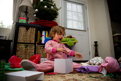 toddler opening presents christmas morning