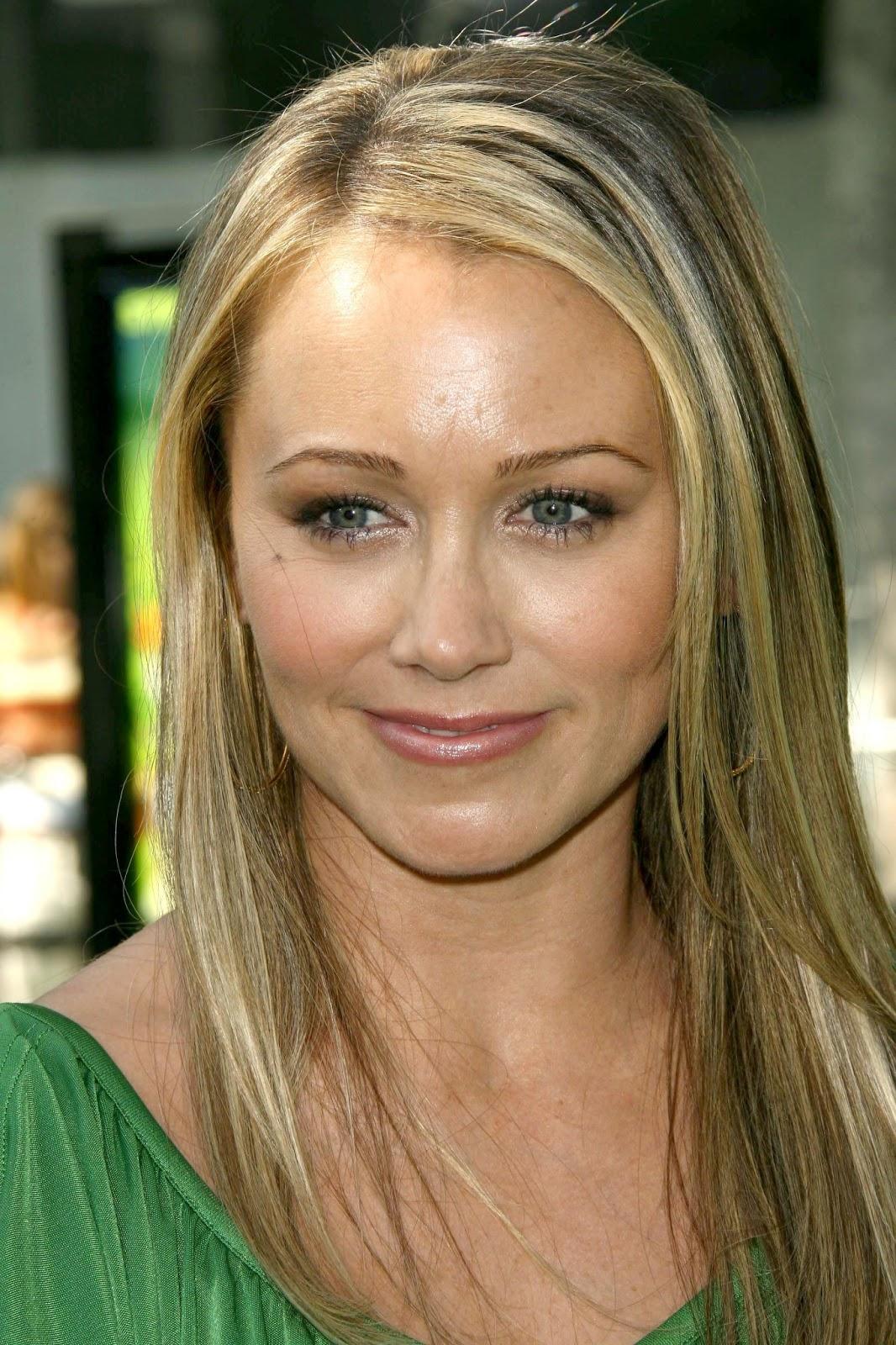 Christine Taylor sporting blond...