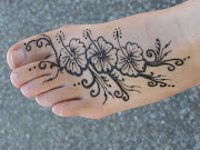 Henna tattoos on foot for girl, women henna tattoo for girls
