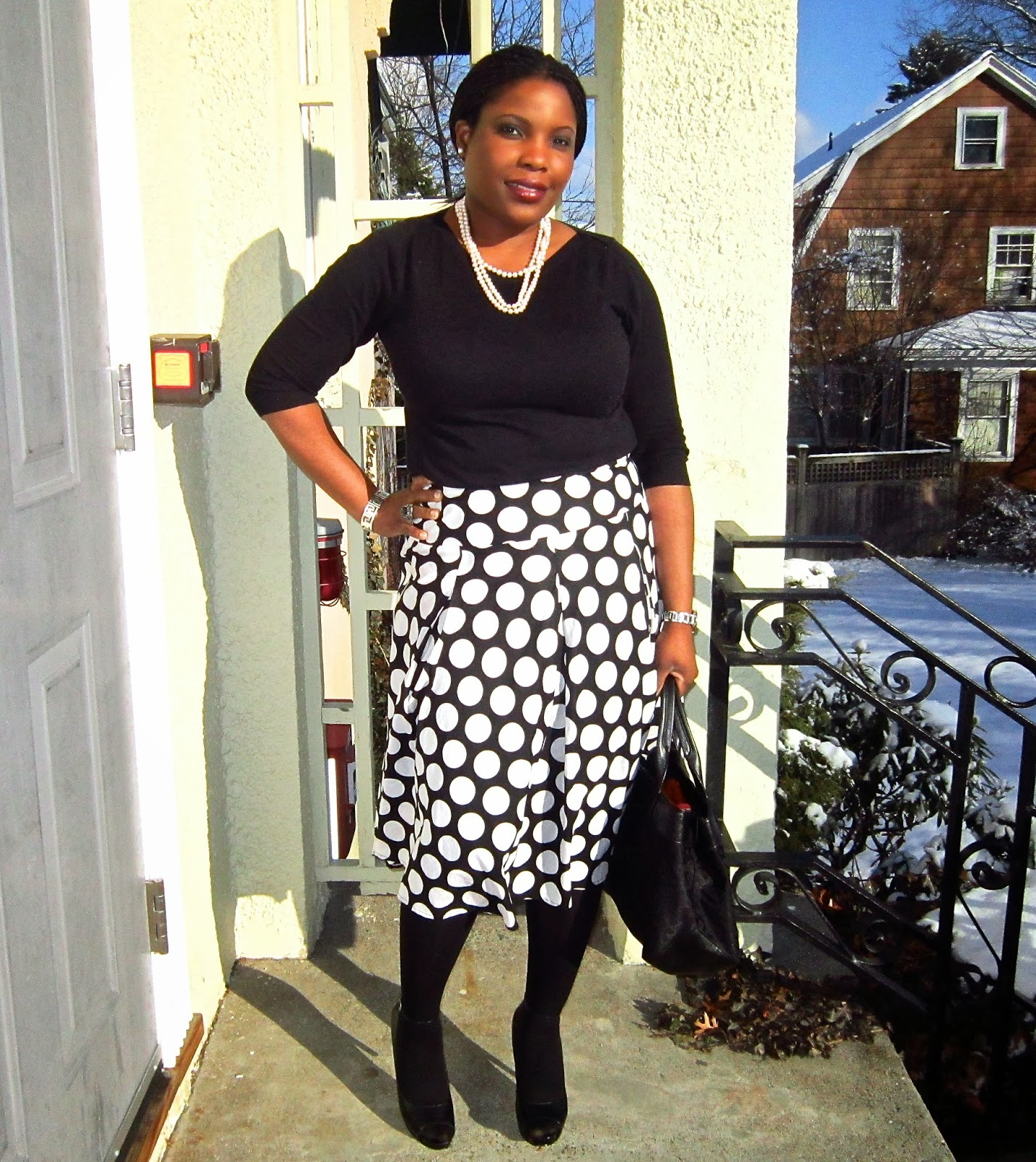 Polka dot skirt, sandals with tights, tommy hilfiger bag, long pearl necklace