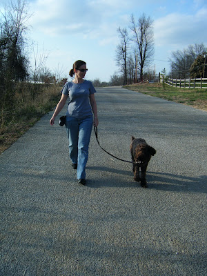 Alf and I exchange a glance as we walk down an empty country road