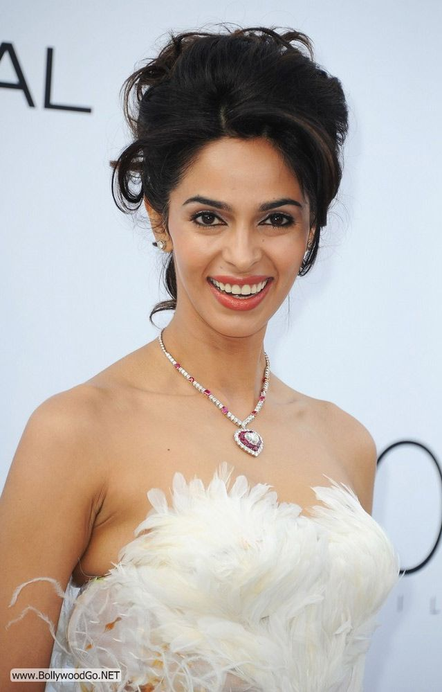 Hot Malika Sharawat New Pictures In White Dress With Light Make Up