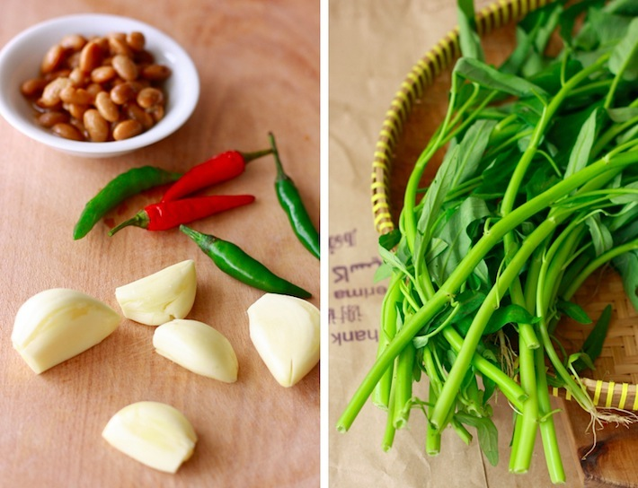 Ingredients for thai stir-fried water spinach - garlic, yellow bean paste, birds eye chili peppers, and kangkong