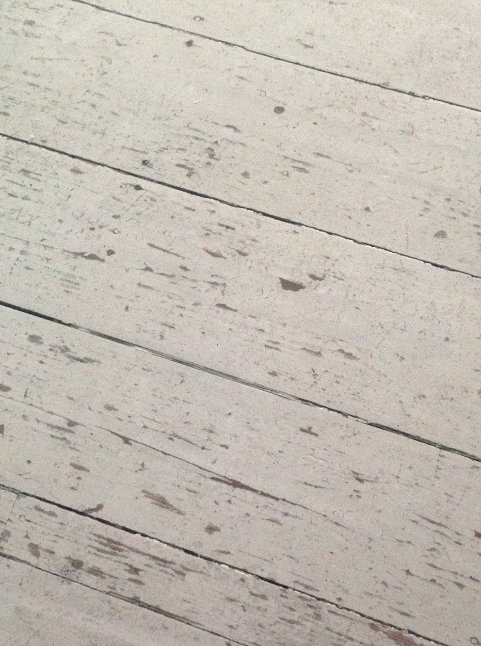 Worn painted floorboards ready for painting