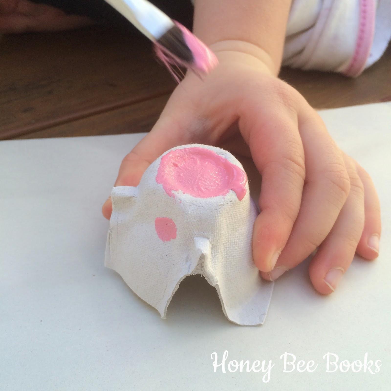 Use an egg carton to create a pig snout