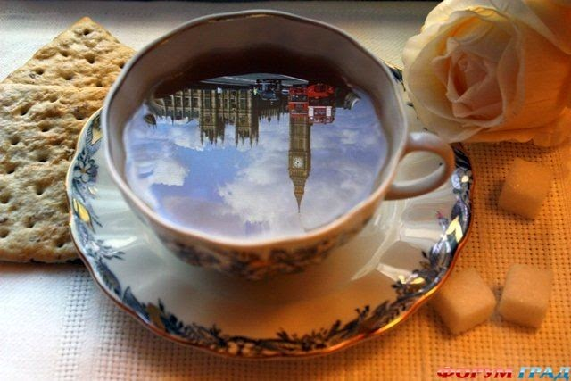 big ben reflection in a cup of tea