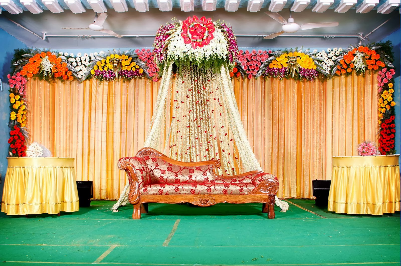Jana poojitha services cloth flower decorated stage 002 for Background decoration