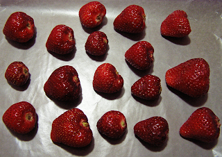Strawberries on Wax Papered Cookie Sheet