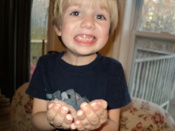 Nicholas lost his first tooth!  2-22-11