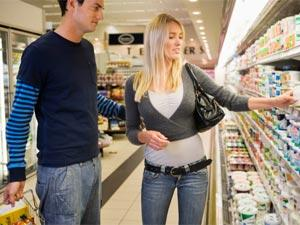 Tips To Deal With A Shopaholic Girlfriend - man and woman at supermarket