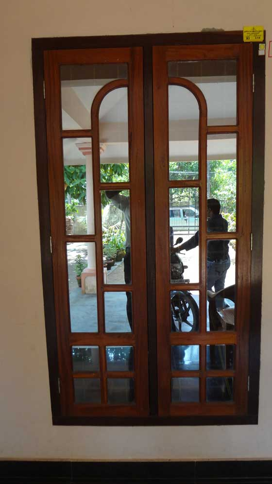 Latest kerala model wooden window door designs wood for Door and window design