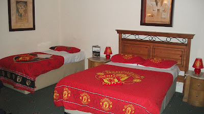 The room is themed to the team, so the sheets, towels, and lamps and whatnot all have the team colours and logo.