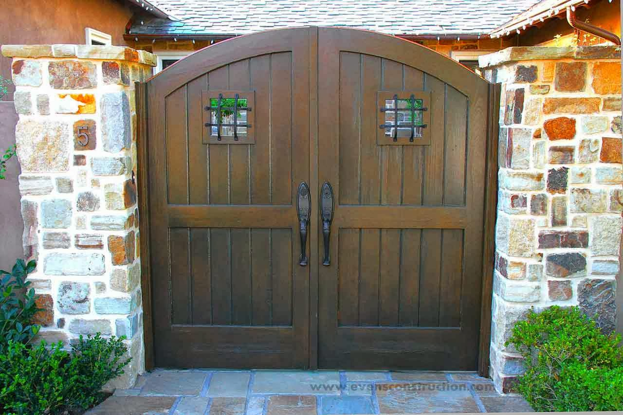 Evens construction pvt ltd compound walls and gates for Wooden main gate design