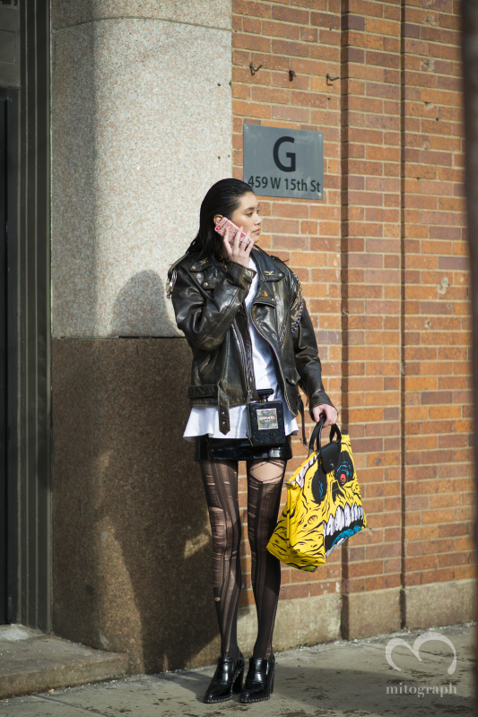 Model Ming Xi carries Jeremy Scott bag and Chanel No5 Clutch bag during New York Fashion Week NYFW