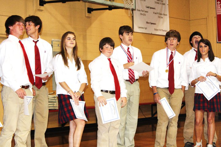 My youngest son Bryan Elmore,the one in the middle with the striped tie. (Spelling Bee win)