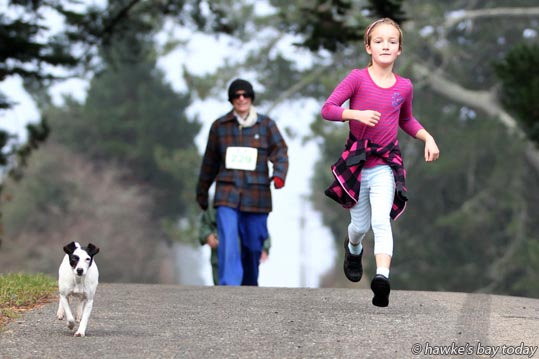 Monique Hermansen, with Patch, running with the slow walkers - Norsewood to Takapau FUN Challenge. photograph