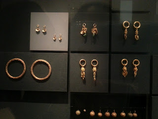 Earrings and bangles in gold