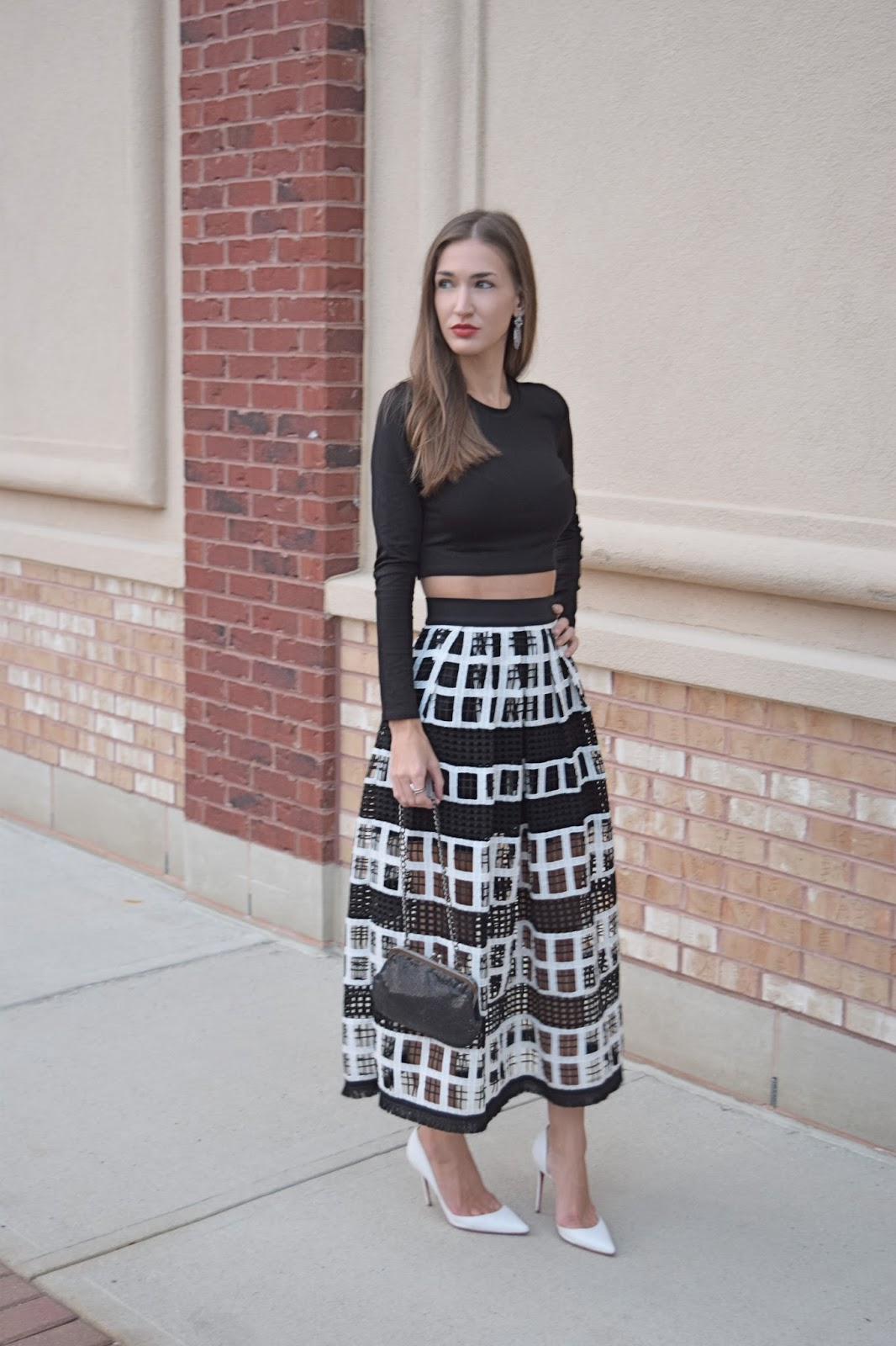 Wearing Alexis Albina Mesh knit midi skirt, Alexis Black long sleeve crop top, Jade's Closet