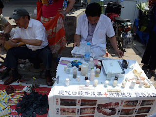 Dental services at the Fahaisi street market in Beijing