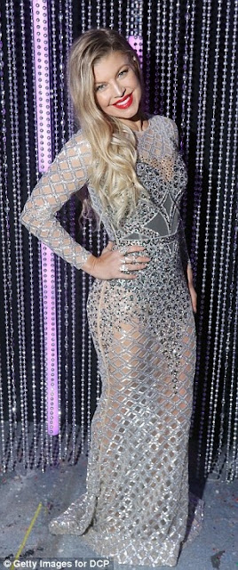 Sheer-ly amazing! Fergie wows in see-through gown as she prepares to co-host New Year's Eve party for EIGHTH year in a row