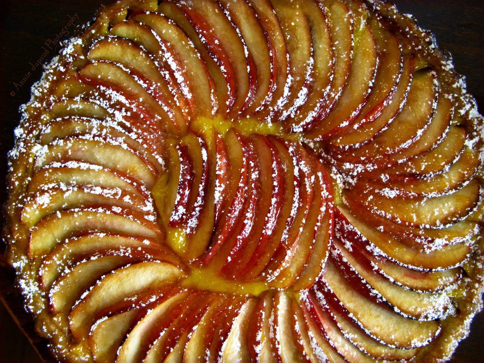 open apple pie with the apple slices arranged on top