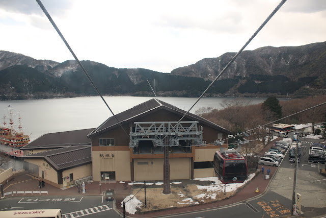 Heading to Owakudani Volcanic Valley by cablecar ride and enjoying the scenery of Lake Ashi and mountains at Hakone, Japan