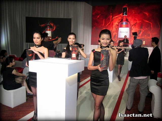 Hennessy ladies showcasing the Hennessy VSOP's new box that came with the bottle